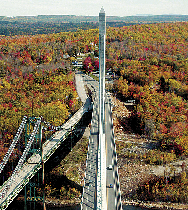 In mid-October, visitors ascending 420 feet to the top floors of the Penobscot Narrows Observatory in Prospect find 360-degree views of the autumn foliage. Fall colors adorn Verona Island just beyond the East Tower of the Penobscot Narrows Bridge (center) and the soon-to-be demolished Waldo-Hancock Bridge (left).