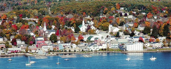 Fall hues decorate the trees bordering downtown Bucksport in this view from the Penobscot Narrows Observatory in Prospect.