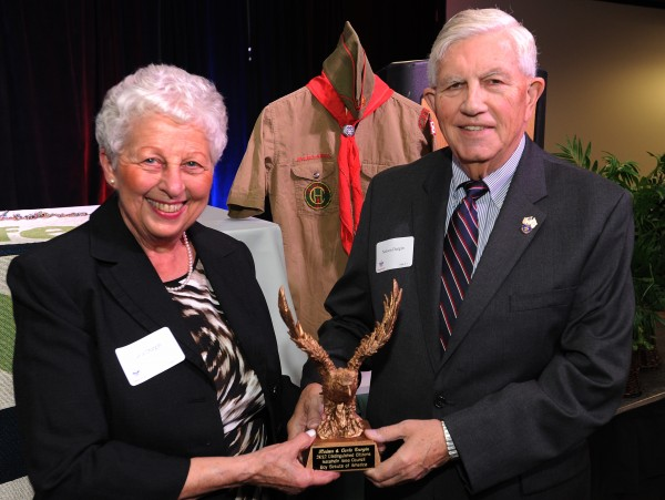 Carla and Nelson Durgin pose with the 2012 Distinguished Citizens Award from the Katahdin Area Council of the Boy Scouts of America on Wednesday, Oct. 24, 2012 at the Bangor Civic Center. Behind Nelson is his scout uniform he wore as a young man.