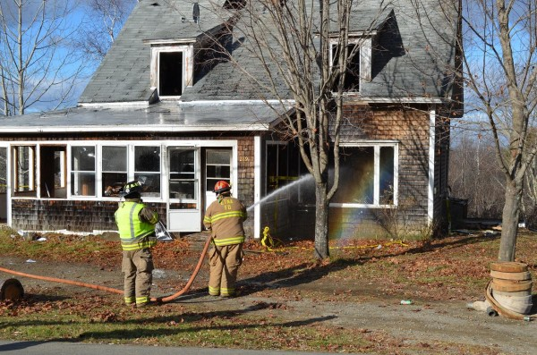 Capt. Walter Gibbons of the Etna Fire Department hoses down a house as part of a multi-department training exercise at 289 West Etna Road on Sunday, Nov. 25, 2012.