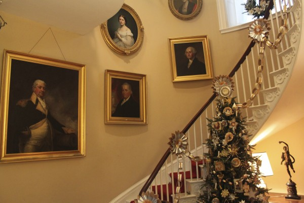 The staircase of the main house Woodlawn Museum in Ellsworth is covered in metallic paper chains made by M.M. Julz Christmas Shop. They joined the many teams of decorators in November 2011 at Woodlawn and were assigned to decorate the hallway and staircase in Victorian fashion.