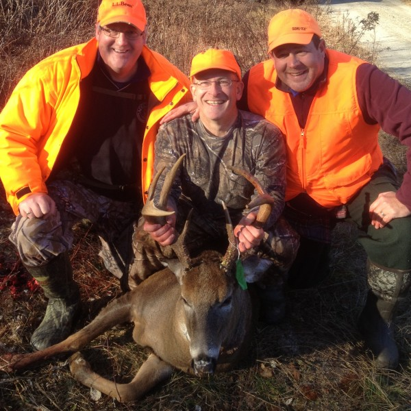 Bangor Daily News assistant sports editor Pete Warner (middle) enjoys the spoils of his &quotrut luck&quot with Chris Lander of Orrington (left) and BDN outdoors editor John Holyoke after shooting a 9-point, 180-pound buck on Nov. 16 in Otis.