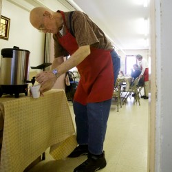 Volunteer Phil Koonce gets a cup of coffee for a noontime diner at the Bath Area Food Bank's thrice weekly free lunch in the basement of the First Baptist Church in Bath on Friday Nov. 9, 2012.