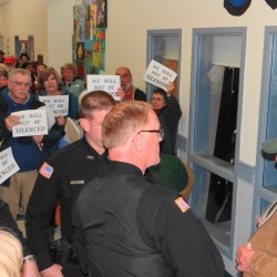 Ben Crimaudo (right) and Searsport Police Chief Dick LaHaye stand outside the planning board meeting Wednesday night, Nov. 28, 2012 as others express their anger after an officer removed Crimaudo from the meeting apparently for creating a disturbance.