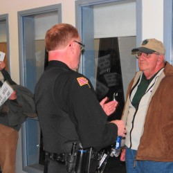 Ben Crimaudo (right) listens as Searsport Police Chief Dick LaHaye explains that Crimaudo can not return to the planning board meeting Wednesday night, Nov. 28, 2012. An officer removed Crimaudo from the meeting apparently for creating a disturbance.