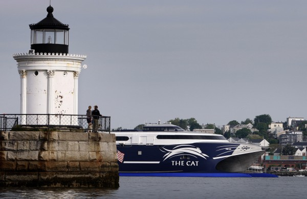 Spectators watch from Bug Light as the high-speed Cat ferry leaves Portland Harbor, bound for Yarmouth, Nova Scotia, Canada, on its first run of the season, Friday, June 5, 2009, in Portland, Maine.