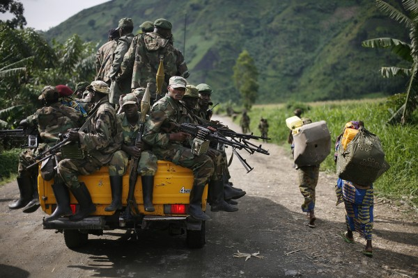 """M23 rebels withdraw from the Masisi and Sake areas in the eastern Congo town of Sake, some 27 kms west of Goma, Friday Nov. 30, 2012. Rebels in Congo believed to be backed by Rwanda postponed their departure Friday from the key eastern city of Goma by 48 hours for """"logistical reasons,"""" defying for a second time an ultimatum set by neighboring African countries and backed by Western diplomats. The delay raises the possibility that the M23 rebels don't intend to leave the city they seized last week, giving credence to a United Nations Group of Experts report which argues that neighboring Rwanda is using the rebels as a proxy to annex territory in mineral-rich eastern Congo."""