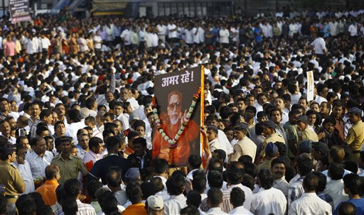 Indian mourners carry a poster of Hindu hardline Shiv Sena party leader Bal Thackeray with the words &quotLong Live&quot during his funeral in Mumbai, India, Sunday, Nov. 18, 2012. Thackeray, the extremist leader linked to waves of mob violence against Muslims and migrant workers in India, died Saturday after an illness of several weeks. He was 86.