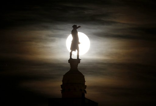 A bronze statue of General George Washington by William Rudolf O'Donovan stands on top of the Trenton Battle Monument while silhouetted by a the light of a full moon shinning on clouds, Thursday, Nov. 29, 2012, in Trenton, N.J. The monument commemorates the victory at the first Battle of Trenton, which occurred on Dec. 26, 1776, and is located where the artillery dominated the streets of Trenton, preventing the Hessian troops from organizing attacks.
