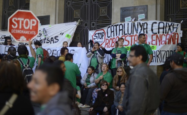 People protest against evictions and banks in front of &quotCatalunya Caixa&quot bank in Barcelona, Spain, Monday, Nov. 5, 2012. The Labor Ministry says the number of people registered as unemployed in Spain jumped by 128,242 people in October as the country's recession showed no signs of easing. The nation's unemployment rate is released separately and quarterly. It stood at 25.02 percent at the end of the third quarter. The jobless rate is 52 percent for those under age 25. Spain, the fourth largest economy among the 17 countries that use the euro, is in its second recession in three years. The banner reads in Spanish: &quotStop evictions&quot, &quotCatalunya Caixa steals, swindling and cheating&quot.