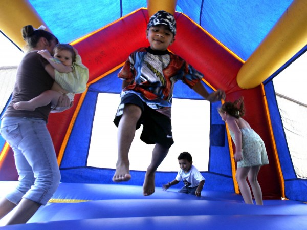 In this Sept. 11, 2005 file photo, children play in a bounce house in Vidor, Texas. A nationwide study released Monday, Nov. 26, 2012, found inflatable bounce houses can be dangerous and the number of kids injured in related accidents has soared 15-fold in recent years. The numbers suggest 30 U.S. children a day are treated in emergency rooms for broken bones, sprains, cuts and concussions from bounce house accidents.