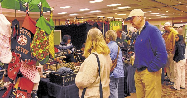 Seeking unique Christmas gifts, shoppers wander the aisles during the 24th Bangor Arts & Crafts Show, held Nov. 3-4 at the Bangor Civic Center and sponsored by United Maine Craftsmen.