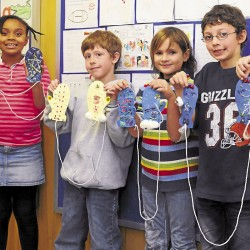 "Aniah, Cole, Hailey, and Ryan are third graders in Mrs. Aube and Mrs. DeDe's class at the Downeast School in Bangor. On Nov. 7, 75 third graders from the Downeast School took part in the ""Mittens from Maine"" community service project."