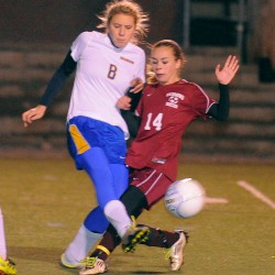 Washburn's Olivia Doody (left) and Richmond's Amber Loon battle for the