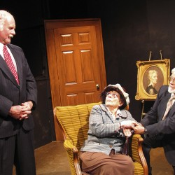 Dr. Chumley (Greg Marsanskis, left) discusses the strange case of Elwood P. Dowd with his sister Veta (Charlotte Herbold, middle), as Judge Gaffney (Doug Coffin, right) offers counsel during a Belfast Maskers performance of &quotHarvey&quot in 2010.