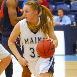 Maine's Liz Wood (31) drives to the basket around a Syracuse player during first-half action at Alfond Arena in Orono Tuesday night, Nov. 13 2012. Syracuse beat Maine 68-44.