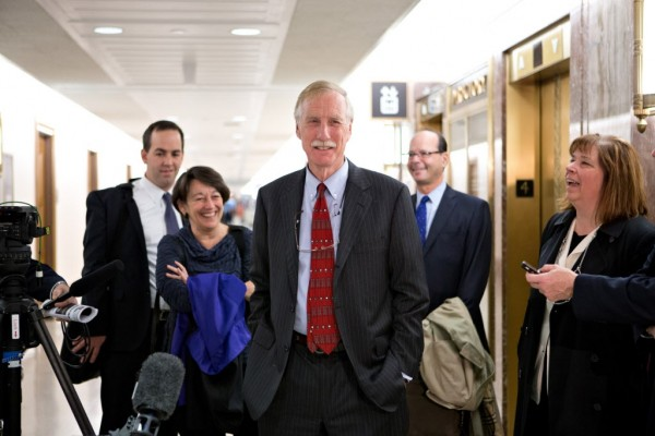 Senator-elect Angus King, I-Maine (center), the former governor of Maine, arrives on Capitol Hill in Washington on Tuesday, Nov. 13, 2012, to meet with Republican Sen. Susan Collins, R-Maine to discuss committee assignments and how they'll work together to represent Maine in the Senate.