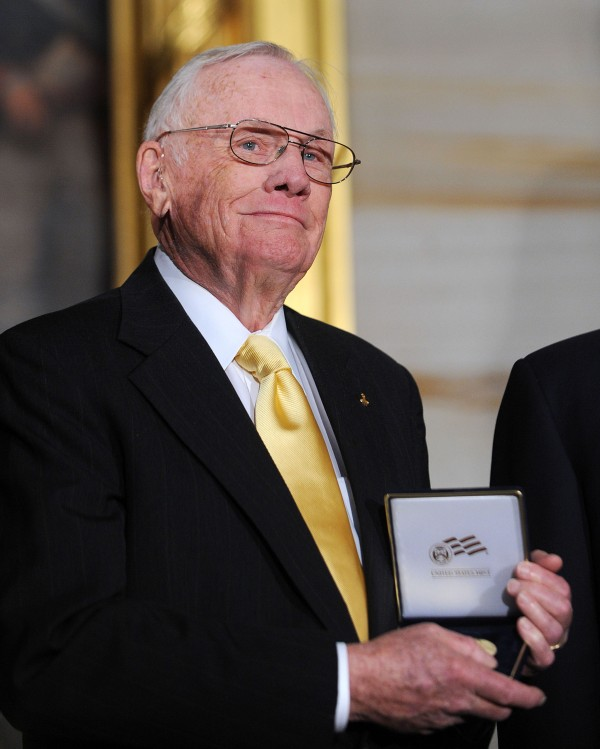 Astronaut Neil Armstrong, commander of Apollo 11 and the first person to walk on the moon, died Saturday, August 25, 2012. He was 82. In this 2011 file photo, Armstrong poses with the Congressional Gold Medal.