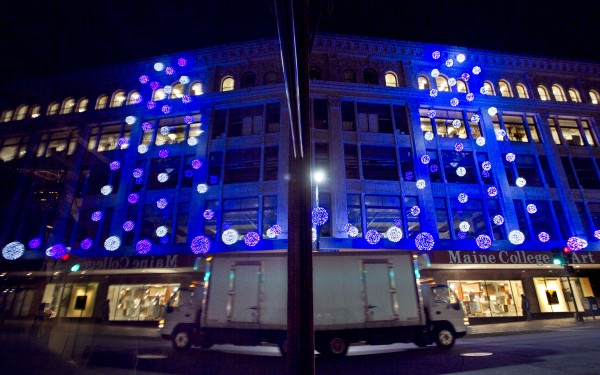 A storefront reflects the lights on display at the Maine College of Art on Congress Street on Thursday, Nov. 29, 2012, in Portland.