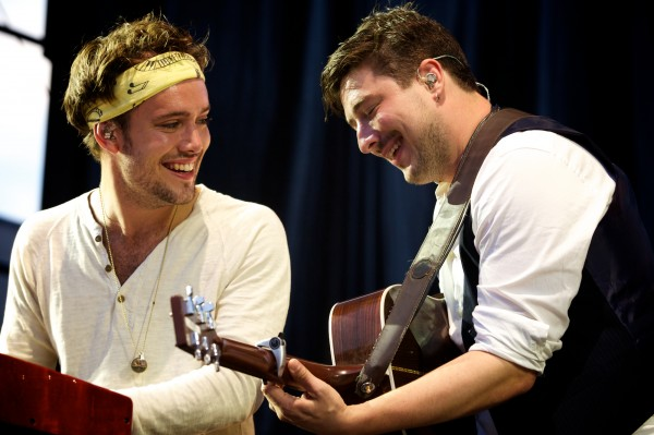 Ben Lovett (left) and Marcus Mumford of Mumford & Sons play off each other at a concert in Portland on Aug. 4. The band has received six Grammy nominations.