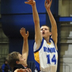 Washburn's Mitch Worcester launches a shot during a tourney game in February 2011 at the Bangor Auditorium. Worcester scored 53 points, including 11 3-pointers, in Washburn's 90-42 victory over Van Buren on Friday night.