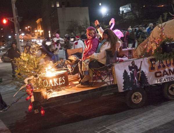 The Paul Bunyan Campground reminded spectators of the the joy of outdoor camping on their entry in the Festival of Lights parade in downtown on Saturday.