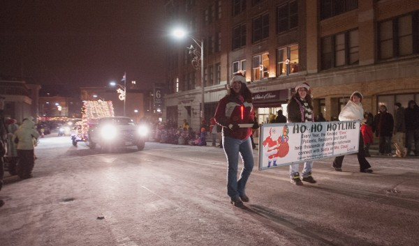 Representatives of the East Side Rehabilitation and Living Center march up State Street in the Festival of Lights parade in downtown Bangor on Saturday.