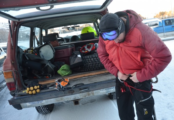 A volunteer member of Kodiak Island Search and Rescue prepares to join a search for a man from Hollis Center, Maine, who went missing after a planned weekend climb of Mt. Barometer in Kodiak, Alaska. Derek Russell's body was found on the mountain Tuesday afternoon.