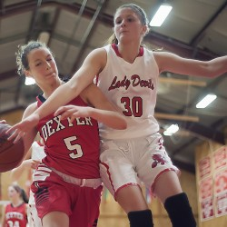 Central's Lauren Gregory (right) and Dexter's Jordyn Bell (left) struggle for a rebound in the first half of their game in East Corinth on Thursday.
