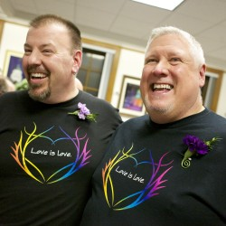Steven Bridges and Michael Snell smile after getting married at Portland City Hall early Saturday morning in Portland.