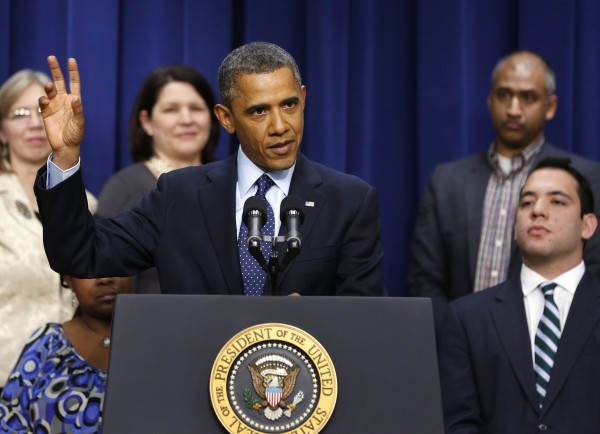 President Barack Obama speaks about the negotiations with Capitol Hill on the looming fiscal cliff in front of middle class Americans while in the Eisenhower Executive Office Building on the White House complex in Washington, Dec. 31, 2012.