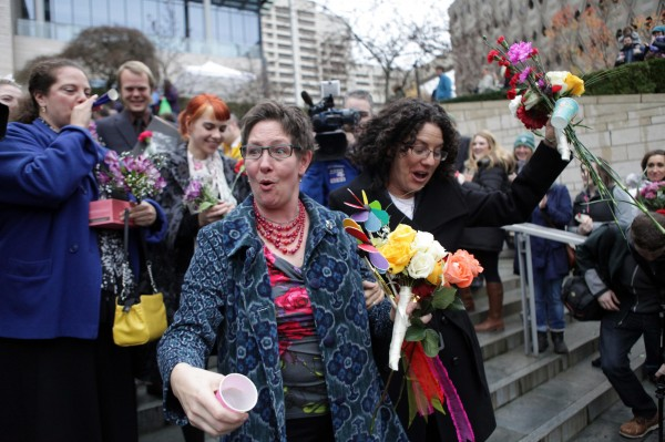 Johanna Flynn (left) and Lori Robb celebrate while walking down the steps of City Hall after getting married at Seattle City Hall in Seattle, Washington, Dec. 9, 2012. Washington made history last month as one of three U.S. states where marriage rights were extended to same-sex couples by popular vote, joining Maryland and Maine in passing ballot initiatives recognizing gay nuptials.