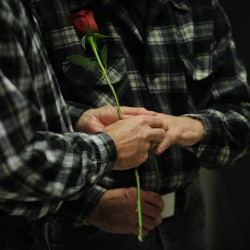 James Beckett (left) puts a wedding ring on the finger of Ken Tidd while getting married at Bangor City Hall on Saturday, Dec. 29, 2012. Beckett and Tidd were the first couple to exchange vows in Bangor after voters approved gay marriage this past November.