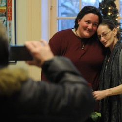 Hope Roger (left) and Margaret Bagg pose for pictures for family members after marrying at Bangor City Hall on Saturday, Dec. 29, 2012. Rogers and Bagg were among the 3 sets of couples that choose to wed the moment they got their marriage certificate at city hall.