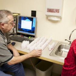 From left, Don Galipeau, RPh, Director of Pharmacy, and Beverly Bickford, a pharmaceutical tech at The Acadia Hospital, prepare methadone treatments in the hospital's pharmacy Dec. 20, 2012. The state of Maine has set a retroactive 2-year cap for those on MaineCare and taking methadone starting January 1.