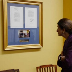 U.S. Sen. Olympia Snowe looks over one of the many bills she worked on that was signed into law.