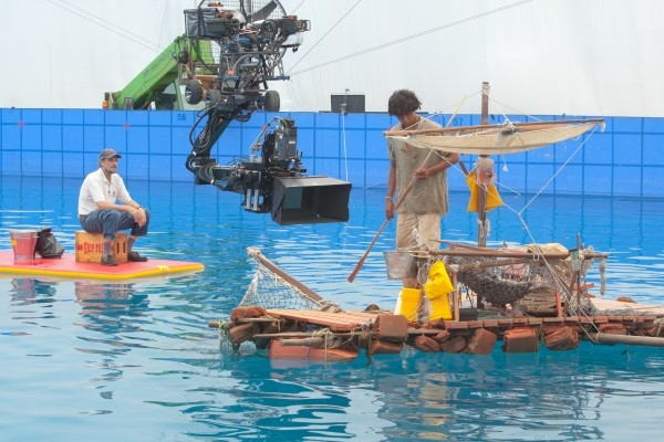 Lamoine resident Steve Callahan sits on a float on a movie set in Taiwan while Suraj Sharma, star of the film &quotLife of Pi,&quot prepares for a scene.
