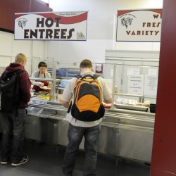 Lois Abraham serves hot lunches to students at Bangor High School on Thursday, Jan. 10, 2013.