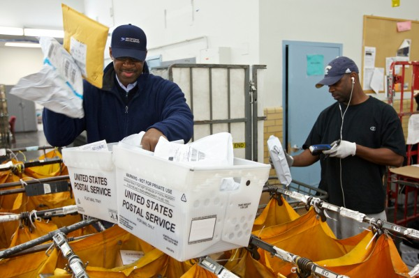 United States Postal Service employees sort mail at the Lincoln Park Carriers Annex in Chicago, on Nov. 29, 2012. The USPS has been grappling for years with high costs and tumbling mail volumes as consumers communicate more online.