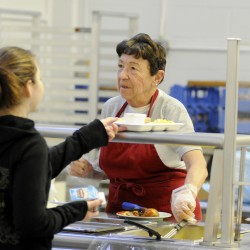 Lois Abraham serves hot lunch to students at Bangor High School on Thursday, Jan. 10, 2013.