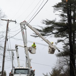 A Bangor Hydro crew works on repairing a downed power line on  Pierce Road in Brewer on Thursday, Jan. 31, 2013.