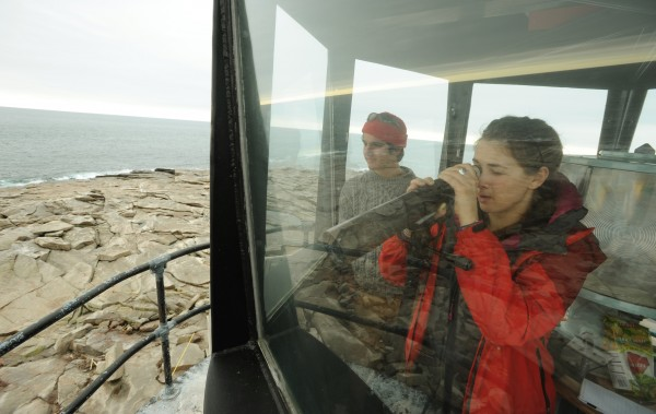 College of the Atlantic students Alex Borowicz (left)and Barbara Beblowski observe a mother seal and her pup from the light house on Mount Desert Rock on Saturday, Jan. 12, 2013.