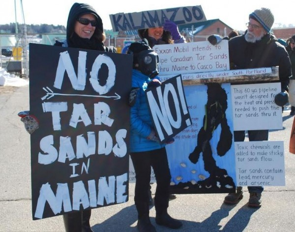 Fryeburg resident Nickie Sekena, her son, Luke Sekena-Flanders, and Porter resident Doug Bowen were among about two dozen people Wednesday protesting the possible flow of Canadian oil extracted from tar sands into South Portland.