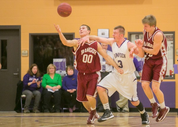 Hampden Academy's Brian Fickett (center) wrestles for a loose ball between Bangor's Nick Ashey (left) and Alex Campbell (right) on Friday, Jan. 18, 2013.