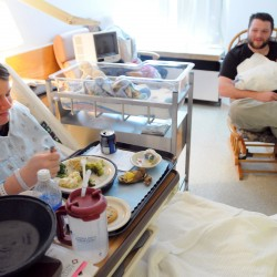 Joseph Lane of Ellsworth holds his infant son, Jarrek MacDonald, while Jarrek's mother Jessica MacDonald eats her lunch at Eastern Maine Medical Center in Bangor Tuesday. Jarrek was born at 2:54 a.m., making him the second baby born at EMMC in 2013.