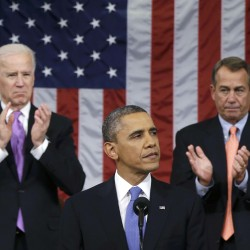 U.S. House Speaker John Boehner (right) and Vice President Joe Biden (left) stand to applaud as President Barack Obama delivers his State of the Union speech on Capitol Hill in Washington, Feb. 12, 2013.