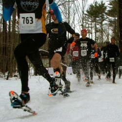 Competitors race down a trail at Bradbury State Park for Bradbury Blizzard's 2012 Snowshoe Race, which was held during the first Great Maine Outdoor Weekend, a schedule of outdoor events organized throughout Maine on March 2-4, 2012.