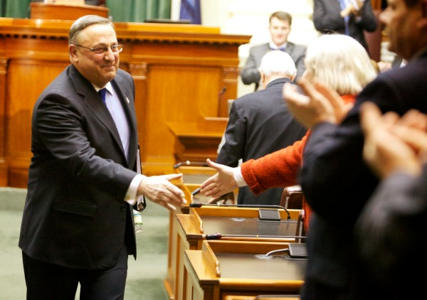 Maine Gov. Paul LePage shakes hands after giving his State of the State address in in the house chambers in Augusta on Tuesday, Feb. 5, 2013.