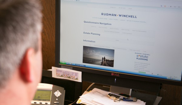 Jeff Solari, manager of business development at Rudman Winchell, scrolls through the law firm's new online legal resources on Wednesday, Feb. 6, 2013.