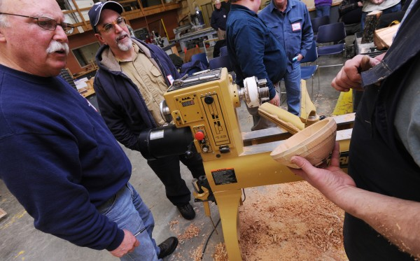Wood turners get a close-up look at a bowl turned from a block of cherry wood by Carl Winter during a demonstration at Eastern Maine Community College on Thursday, Jan. 31, 2013 during the monthly meeting of Eastern Maine Woodturners.